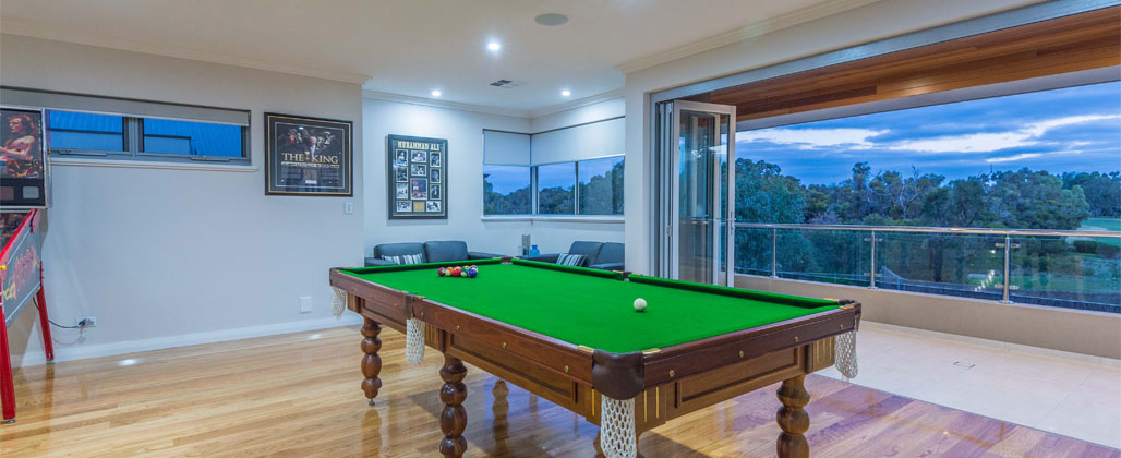 Snooker Room With Stack Doors Opening To A Balcony